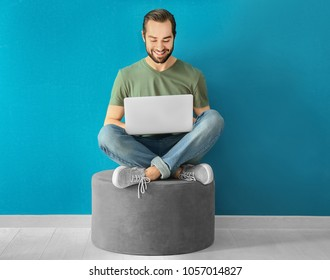 Young man using laptop indoors