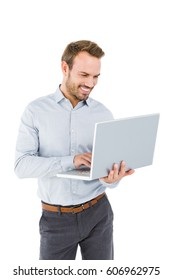 Young man using laptop on white background