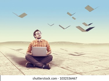 Young man using a laptop and watching laptops flies like birds. The concept of creative mind .