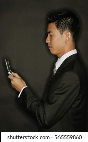 Young man using mobile phone, text messaging