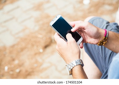 Young man using mobile smart phone