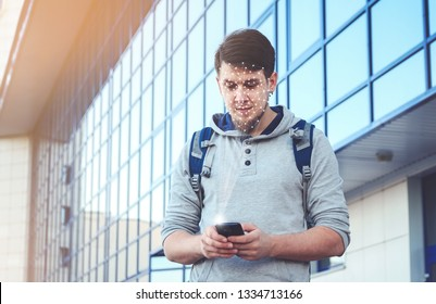 young man using new smartphone with face id technology
