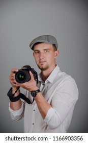 Young man using a professional camera in studio