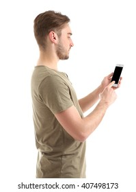 Young man using smart phone, isolated on white