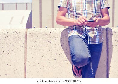 a young man using a smartphone outdoors