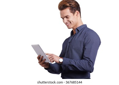 young man using tablet computer against a white background