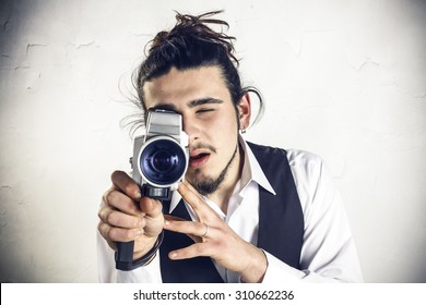 Young man using a vintage camera