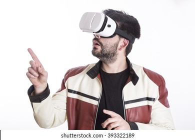 Young man using virtual reality glasses while pointing fingers at something