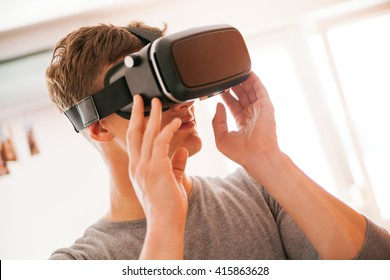 Young Man Using VR In The Living Room