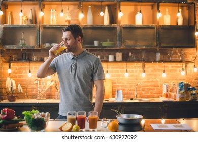 Young man vegan drinking juice healthy lifestyle