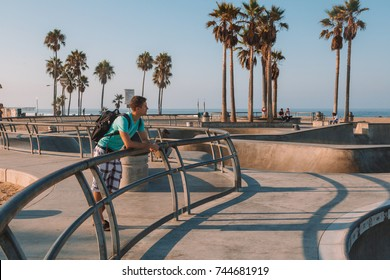Young man at the Venice beach skate park in Los Angeles. Beautiful warm Monday morning.