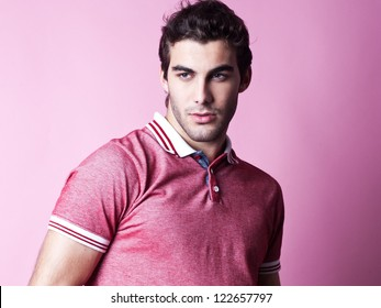 young man with very handsome face in red casual shirt