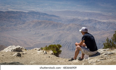 Young man viewing the San Bernadino mountains from Keys View in the Joshua Tree National Park, California