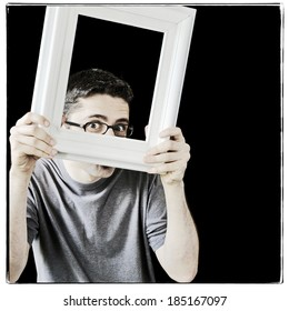 Young man with a vintage white picture frame, instagram style