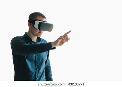 Young man with virtual reality glasses. Modern technologies. The concept of future technology.