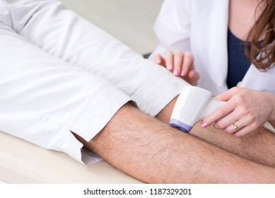 Young man visiting doctor for epilation