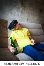 Young Man in VR Mask with a Beer sleep on the Sofa