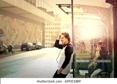 Young man waiting at the bus stop