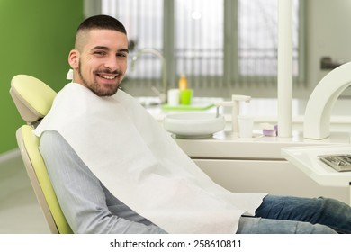 Young Man Waiting For A Dental Exam