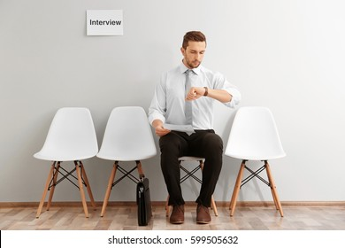 Young man waiting for interview indoors