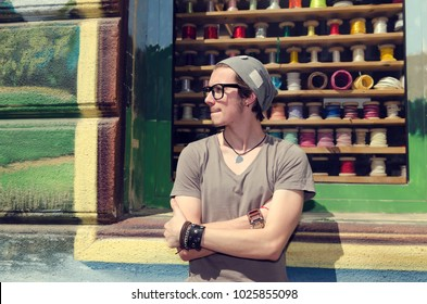 Young man waiting on a street
