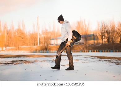 Young man walk by street with guitar and singing, music concept
