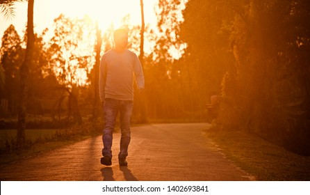 Young man walking around a curvy urban street in the afternoon