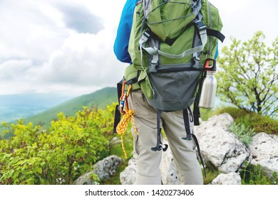 Young man Walking With Backpack
