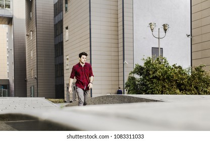 Young Man walking in the city