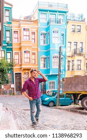 young man walking at the colorful streets of Istanbul, Balat district streets view with colorful homes in Istanbul