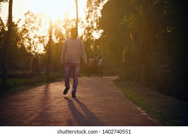 Young man walking in an empty street in the afternoon