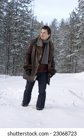 young man walking in forest
