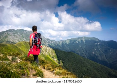Young man is walking on the mountain