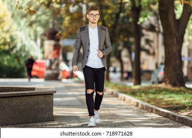 Young man walking on the street with blur background