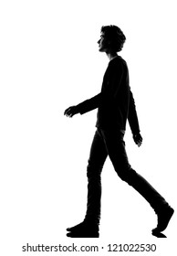 young man walking silhouette in studio isolated on white background