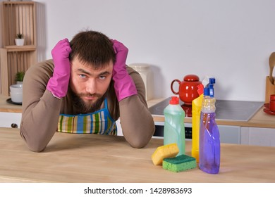 Young man wanted to help his wife in housecleaning, but he doesn't know what to do with all of detergents