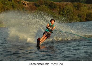 young man water skiing