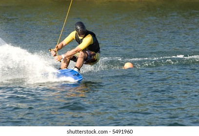young man water skiing on a sea