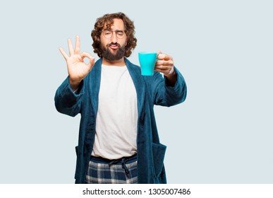 young man wearing bathrobe night suit having a coffee