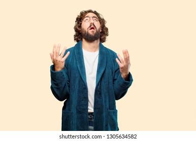 young man wearing bathrobe night suit sad pose