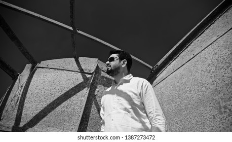 Young man wearing black sunglasses standing in a place