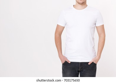 Young man wearing blank white t-shirt isolated on white background. Copy space. Place for advertisement. Front view