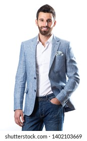 A young man wearing a Blazer in blue jeans on a white background