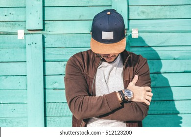 Young Man Wearing Blue Blank Cap with beige visor, Front view. Horizontal Mockup
