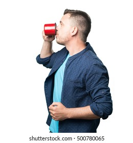 Young man wearing a blue outfit. Holding a red cup. Showing profile and drinking.