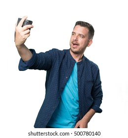 Young man wearing a blue outfit. Taking a selfie.