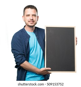 Young man wearing a blue outfit. Holding a blackboard.