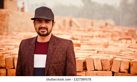 Young man wearing a cap standing around a place unique photo
