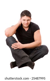 Young man wearing casual closes sitting isolated on white