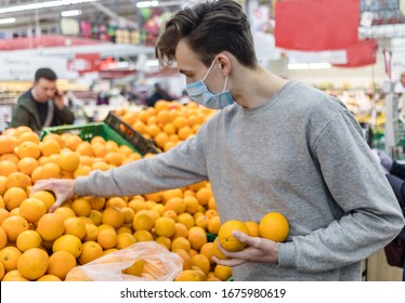 Young man wearing disposable medical mask shopping in supermarket during coronavirus pneumonia outbreak. Protection and prevent measures while epidemic time. Covid-19 person